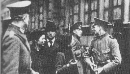 German officers stop Jewish women to ask for their identification cards on a city street in Berlin, circa 1920.