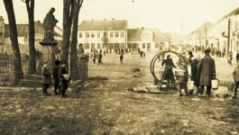 Rare historical photograph of the Bodzentyn ghetto showing men, women, and children marketplace in 1941.