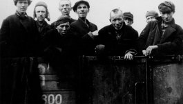Photograph of survivors of the death camps arriving in Theresienstadt ghetto by truck at the time of liberation.