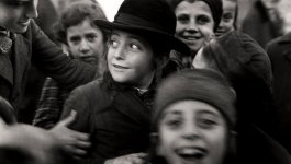 Several Jewish schoolchildren jostle each other. Taken circa 1935-1938.