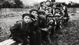 Young boys on a bench in Sighet, Poland. Circa 1920.