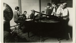 "Photograph of a recording session featuring musicians Steve Cropper, Donald ""Duck"" Dunn, Tom Dowd, David Porter, Julius Green, Andrew Love, Floyd Newman, Wayne Jackson, and Isaac Hayes."