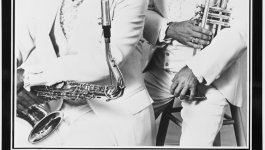 Poster of the Memphis Horns. Andrew Love is holding a saxophone and Wayne Jackson is holding a trumpet.