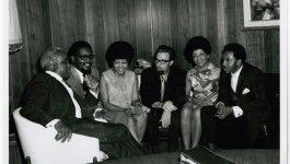 A meeting between The Staples Singers and the owners of Stax Records William Bell and James Lewis in Tennessee