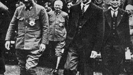 Japanese Prime Minister Hideki Tojo walking with Wang Jingwei a Chinese revolutionary leader and associate of Sun Yat-sen.