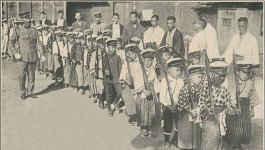 Photograph of boy scouts marching with rifles, circa 1926.