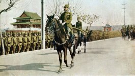 General Iwane Matsui salutes his troops as he rides on horseback into Nanjing.