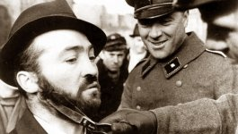 German officers forcefully cutting off a Jewish man's beard.