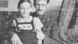 Photograph of poet and resistance member Abraham Sutzkever posing with child artist Zalmen Bok (Sam Bak).
