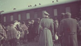 Photograph of Jewish people boarding a train for deportation from the Łódź ghetto to the Chelmno death camp in April 1942.