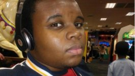 Michael Brown wearing headphones.