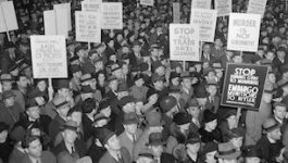 A group of people at a mass demonstration on immigration during the 1930s