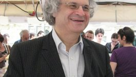 French author Amin Maalouf attends at an outdoor book fair.
