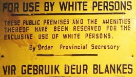 "Sign in English and Afrikaans: ""For Use by White Persons/ These public premises and the amenities thereof have been reserved for the exclusive use of white persons/ by Order Provincial Secretary"""