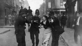 Woman being arrested.