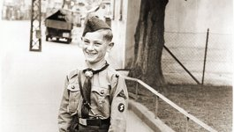 A boy poses in his Hitler Youth uniform