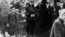 Women and children wearing star badges at Auschwitz-Birkenau.