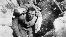 A Still image from the 1915 propaganda film The Battle of Somme. A World War I soldier carries a body on his back.