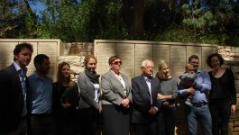 Dr. Avraham Horowitz, Holocaust survivor, stands with Małgorzata-Ana Gronek, granddaughter of his rescuers, and his family at Yad Vashem.