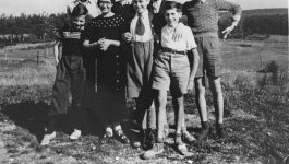 A group of Jewish children pose outside in the town of Le Chambon.