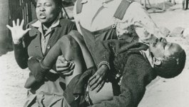 Mbuyisa Makhuba, a black South African young man carries the dead body Hector Pieterson, age thirteen.
