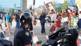 A police officer overlooking a protest.