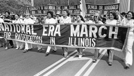 "Women hold a banner reading ""National ERA March for Ratification in Illinois."""