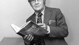 """A portrait of author Jacob Bronowski, holding his book, """"The Ascent of Man."""""""