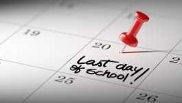 Red pin on calendar date for the last day of school.