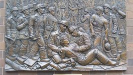 Relief depicting firefighters providing aid on 9/11.