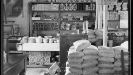 An old country store contains sacks of food and other items for purchase.