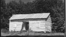 A cabin where an African American family lived, in rural  Hale County, Alabama during the Great Depression.