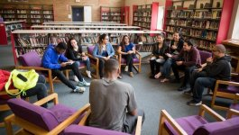 students talking in a circle