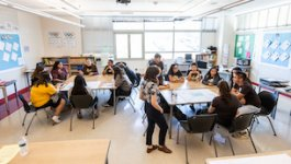 Birds eye view of a classroom with students at three different tables.