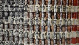 An American flag made up of photos of individual faces.