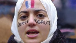 The book cover for What Do We Do with a Difference? Cover includes the title and an image of a Muslim woman wearing a headscarf with the French flag painted on her forehead, and the word Liberté on her left cheek and Egalité on her right cheek.