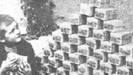 young children stack large piles of currency during a time of high inflation in Weimar republic.