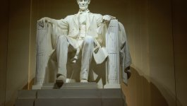 Statue of Lincoln at the Lincoln Memorial at night.