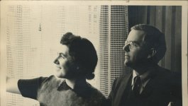Black and white photo of Martha and Waitstill Sharp looking out window.
