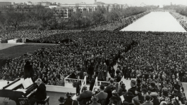 View of a large crowd of people with the Lincoln Memorial in the background.