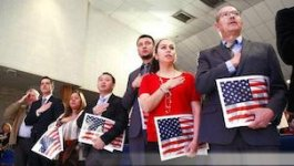 Oklahoma residents take the naturalization oath to become American citizens.