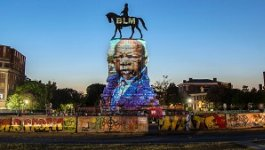 Graffiti and a film projection on the Robert E. Lee monument in Richmond, Virginia (2020).