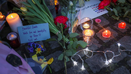 Temporary Memorial for Sarah Everard with flowers, candles, and lights.