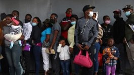 A group of Haitian migrants wait in line at the Mexican Commission for Aid to Refugees (COMAR).