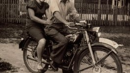 Woman and man on a motorcycle