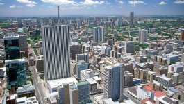 Birds eye view of Johannesburg with many tall modern buildings.