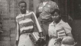 Image of Melba Patillo Beal on school steps with National Guard officer in the background.