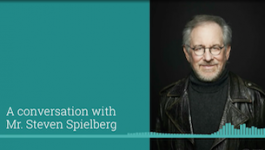 """An image of filmmaker Steven Spielberg in a leather jacket, captioned """"A conversation with Steven Spielberg"""""""