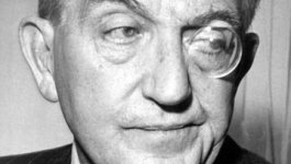 Portrait of film director Fritz Lang wearing a monacle.