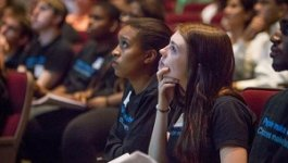 Young women watching a speaker or presentation